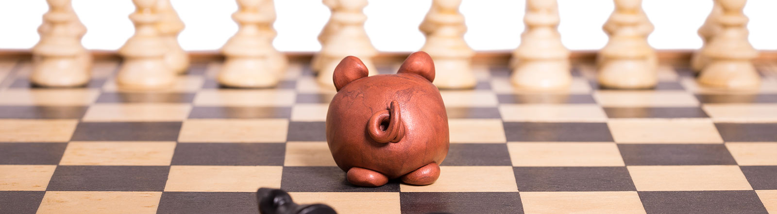 Piggy bank on chess board.