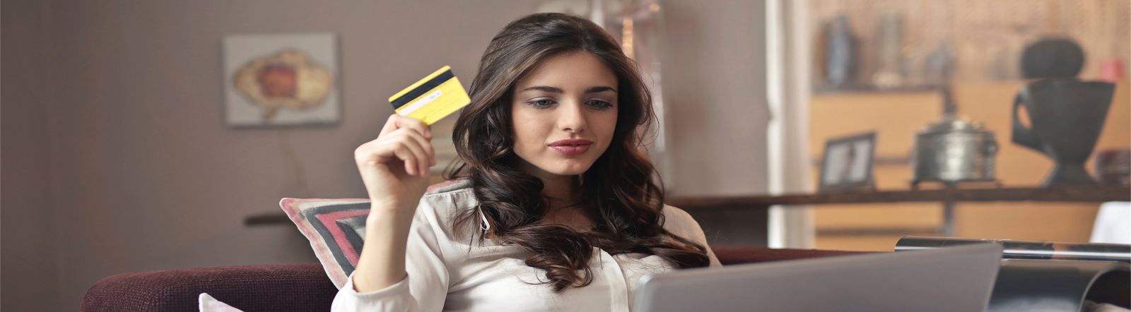 Girl with credit card shopping online.